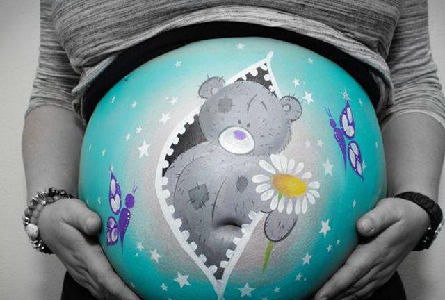 Рисунки на животах беременных