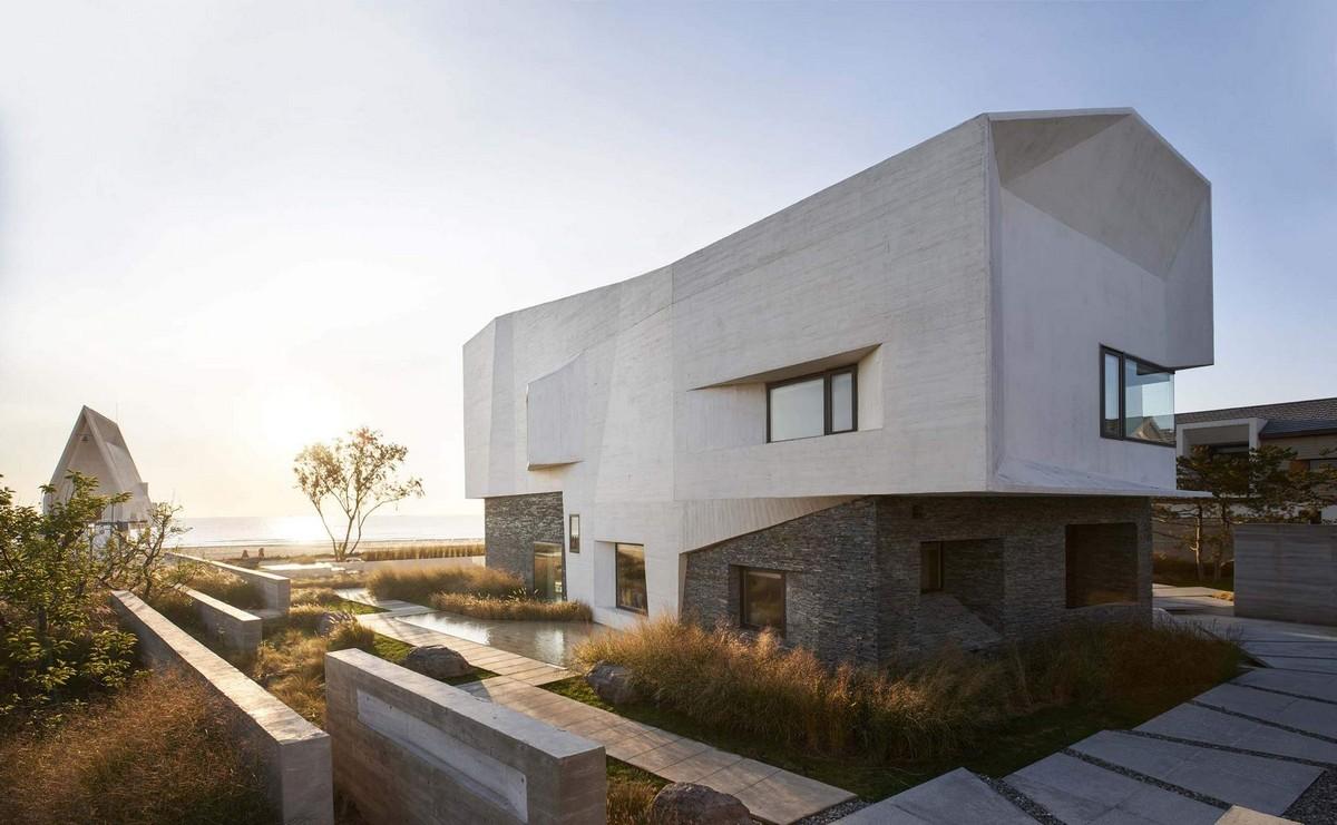 Современная вилла с волнистым бетонным фасадом в Китае