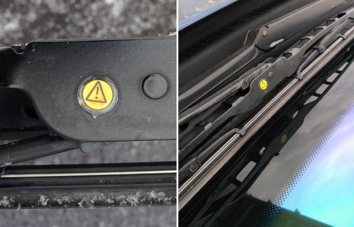 Для чего нужны жёлтые наклейки на стеклоочистителях